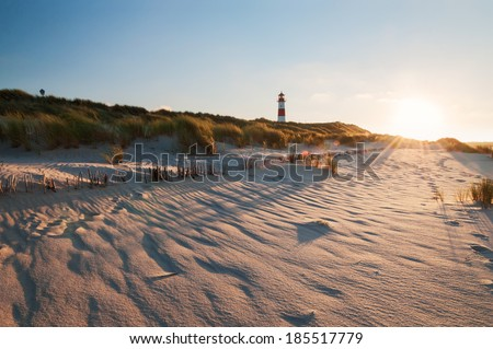 The lighthouse List East on Sylt. It was constructed in 1857 and is located on the peninsula Ellenbogen near the city of List. From the lighthouse the Danish coast can be seen. - stock photo