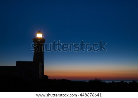The lighthouse of Syracuse before the dawn against a starry sky