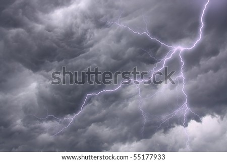 The lighting in dark stormy clouds - stock photo