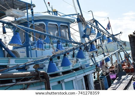 The lighting lamp is blue colour with the fishing boat
