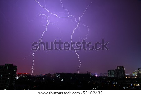 The lightning in the night sky of city - stock photo