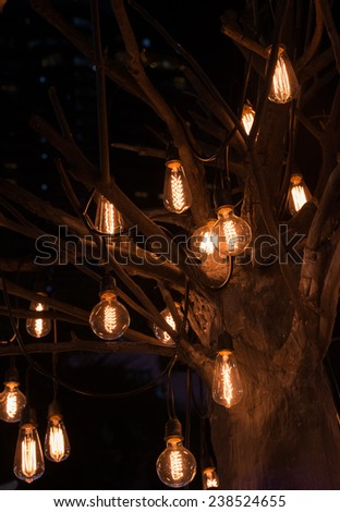 The lights from a light bulb hanging
