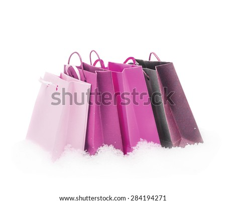 The lilac gift packages stand on snow, isolated on the white - stock photo