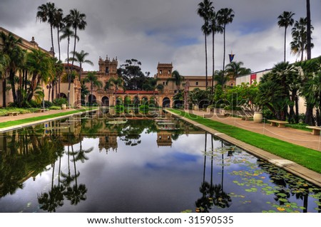 The Lily pond, reflecting the casa de Balboa and House of Hospitality at Balboa Park, San Diego (HDR image) - stock photo