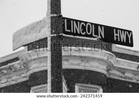 """The """"Lincoln Highway"""" sign on a snowy winters day in Rochelle, Illinois. - stock photo"""
