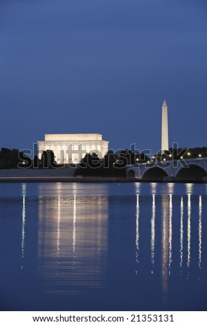 The Lincoln Memorial and Washington Monument viewed from across the Potomac River at night; Memorial Bridge to the right. - stock photo