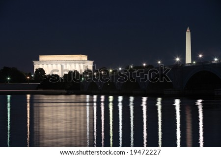 The Lincoln Memorial, Memorial Bridge and Washington Monument reflected in the Potomac River at night. - stock photo