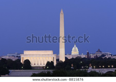 The Lincoln Memorial, Washington Monument and United States Capitol at night.