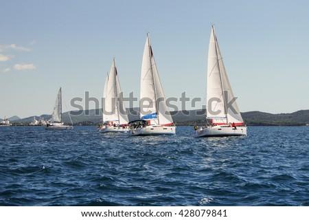 "The line of yachts under sail. Tivat, Montenegro - 26 April, 2016 Regatta ""Russian stream"" in God-Katorskaya bay of the Adriatic Sea off the coast of Montenegro. - stock photo"