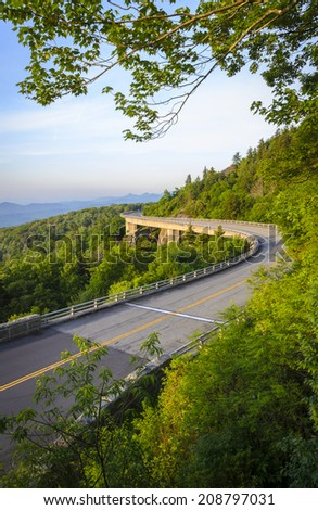 The Linn Cove Viaduct at sunrise along the Blue Ridge Parkway - stock photo