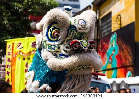 The Lion Dancing at the arrival of the Chinese New Year