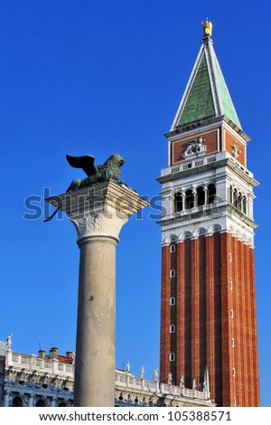 The lion of Venice and San Marco Campanile -  St Mark's Campanile bell tower of St Mark's Basilica located in the Piazza San Marco in Venice, Italy   - stock photo