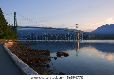 The Lion's Gate Bridge at sunrise. - stock photo