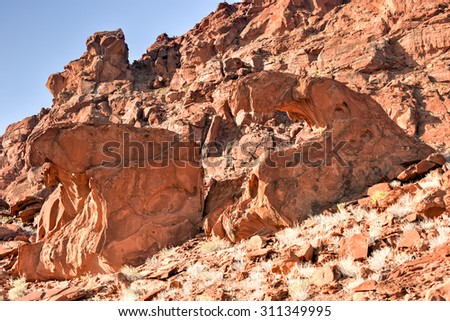 The lion's mouth rock formation throning on top of Huab valley in Twyfelfontein, Namibia. - stock photo