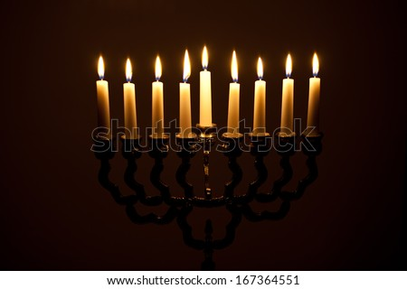 The lit of hanukkah candles - stock photo