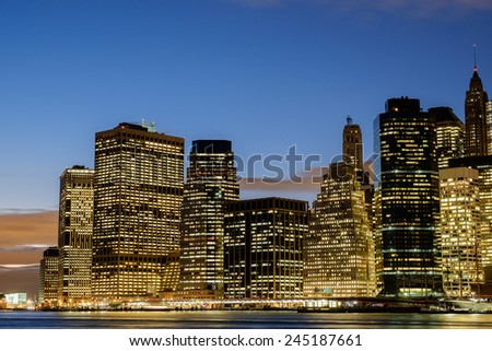 The lit office buildings of the Lower Manhattan New York City Financial District - stock photo