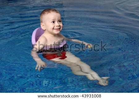 The little boy bathes in pool