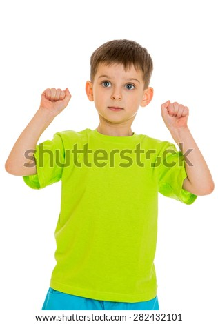 the little boy clenched his hands into fists- isolated on white background - stock photo