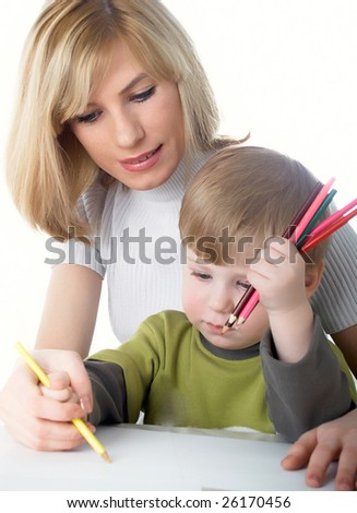 The little boy draws pencils with mum - stock photo