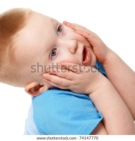 The little boy emotionally grabbed hold of the face isolated on white background - stock photo