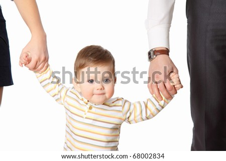 The little boy hold the parent's hands