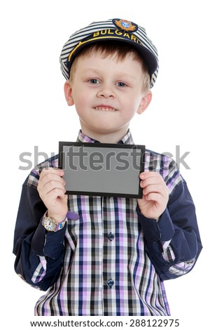 The little boy holds up a in the hands of a rectangular gray card-isolated on white background