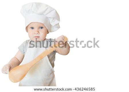 The little boy in a suit of the cook sculpts dough. Baby make dinner in chef suit isolated on white. Cooking concept with free text space - copy space