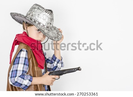 The little boy in a suit of the cowboy  - stock photo