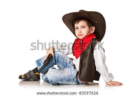 The little boy in a suit of the cowboy on a white background