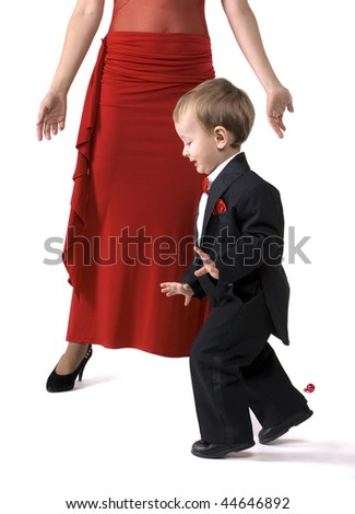 The little boy in a suit tiptoes - stock photo