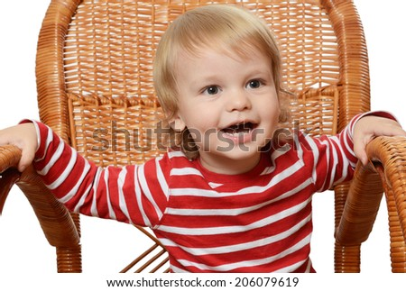 The little boy in an armchair isolated - stock photo