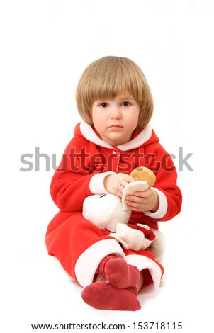 The little boy in clothes of Santa Claus with a toy