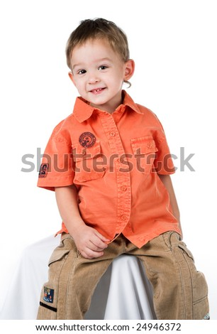 The little boy on a white background in a red shirt