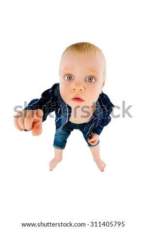The little boy on a white background pointing her finger at the camera. Wide viewing angle - stock photo