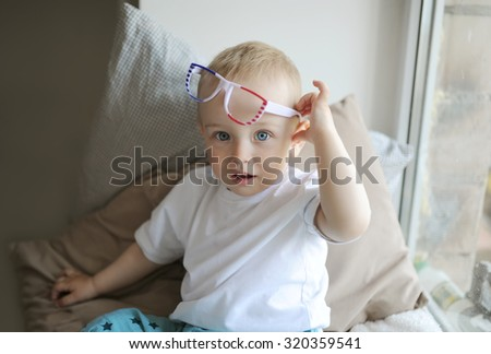 the little boy plays with glasses - stock photo