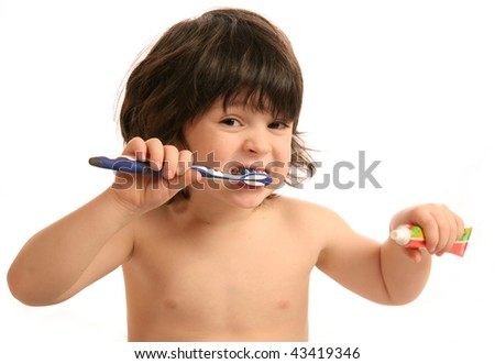 The little boy with a tooth-brush - stock photo