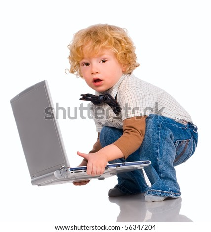 The little boy with curly hair holds in hands notebook - stock photo