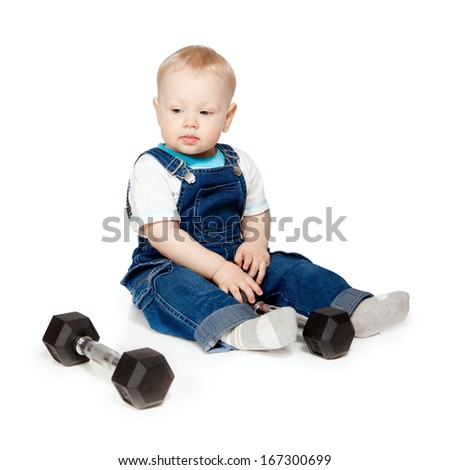 The little boy with dumbbells. Isolated on a white background. - stock photo