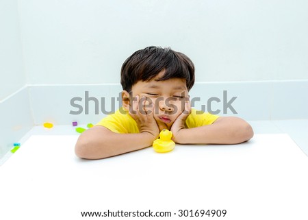 The little boy with moody emotion. - stock photo
