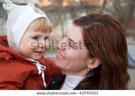 The little boy with mum on walk in the spring - stock photo