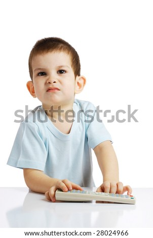 The little boy with the control panel from the TV - stock photo