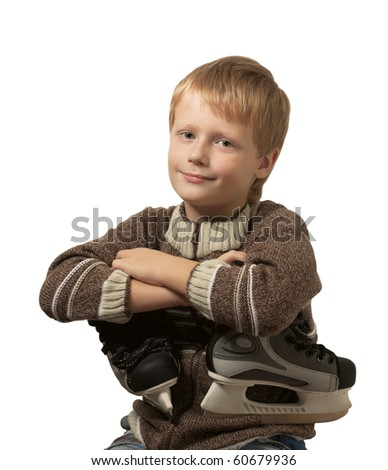 The little boy with the skates in a knitted sweater smiles in camera. Isolated on white background. - stock photo