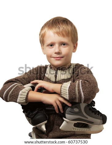The little boy with the skates in a knitted sweater smiles in camera. Isolated on white background.