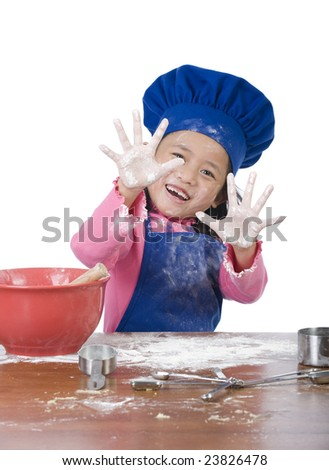 The little chef making a mess in the kitchen - stock photo