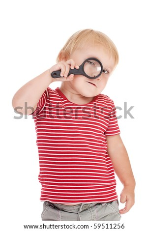 the little child with magnifier on her eye - stock photo