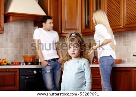 The little girl against quarrel of parents - stock photo