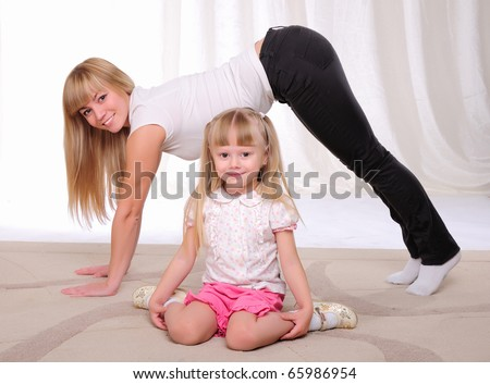 The little girl and her mother engaged in sports