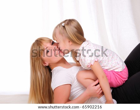 The little girl and her mother together having fun