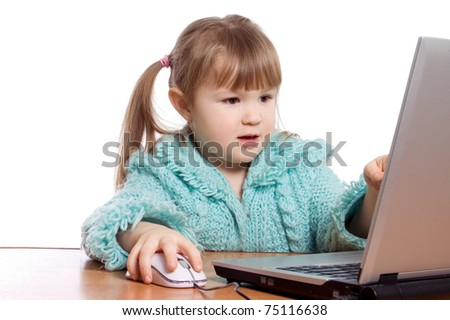 The little girl at the computer