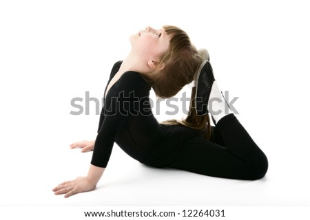 The little girl carries out gymnastic exercises. - stock photo